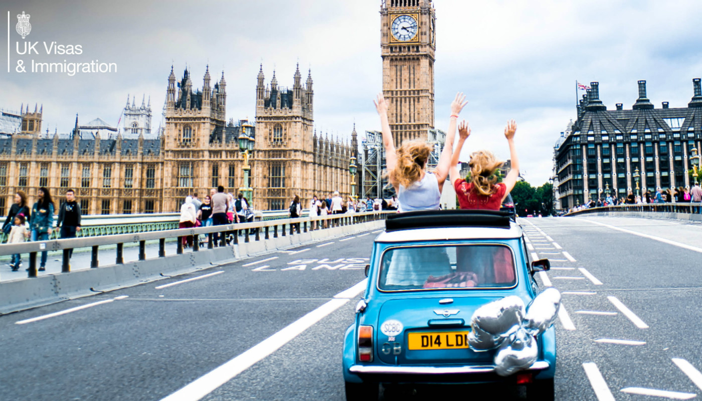 A car driving towards Big Ben, London.